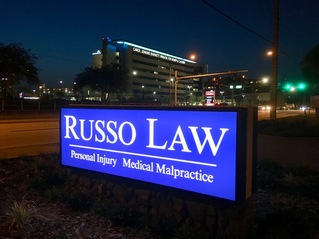 Russo Law Outdoor Sign at Night